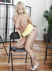 Blond babe Jessica Moore stripping on the chair and fingering her sissy