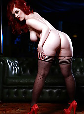 Pale skinned redhead Jaye Rose demonstrates her beautiful big ass, shaved pussy and big boobs