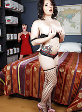 Black haired sweetie Casey Cumz poses in her super sexy fishnet stockings