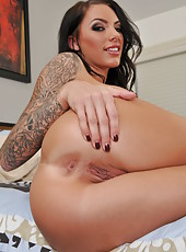 Horny brunette bitch Juelz Ventura demonstrates her shaved pussy and big tits