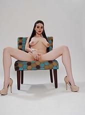 Beautiful brunette girl Tessa Lane shows her big tits and masturbates