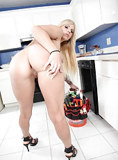 Young and naughty blonde babe Lylith Lavey shows her great body in the kitchen