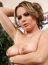 Naughty and horny mommy Alexis May takes off her sexy skirt and masturbates