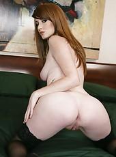 Pale skinned milf Nikki Rhodes undresses her lingerie and masturbates
