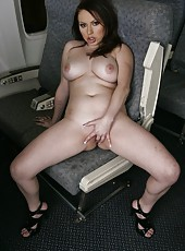 Brunette milf Lily Lovely spreads her legs and plays with a shaved pussy