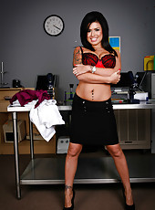 Passionate brunette bitch Eva Angelina undresses her skirt and shows a pussy