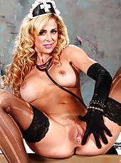 Dulcet blonde milf Cherie Deville looks seductively in her super hot whore-style uniform