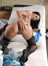 Beautiful dark haired milf doctor Ava Addams demonstrates her big natural boobs