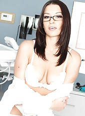 Dark haired milf in sexy glasses Ann Marie Rios poses in hot stockings