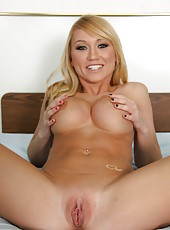 Astonishing blonde babe with perfect skin, bald snatch and hot big tits Madison Scott strips