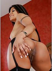 Hot babe Gabby Quinteros posing in black stockings in her bedroom