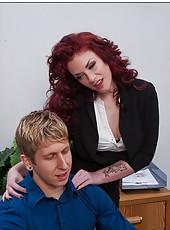 Elegant redhead babe Andy San Dimas sucks a cock in the office