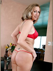 Breathtaking housewife Joey Lynn prefers to strip and shows her awesome ass