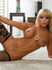 Ravishing babe Houston taking off her skirt and playing with pussy on the bed