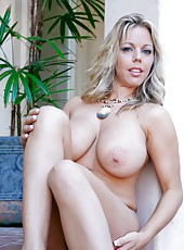 Fascinating hooker Amber Lynn Bach demonstrates big tits and masturbates