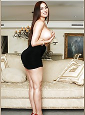 Winning housewife Sheila Marie posing in a sexy dress and fingering sissy