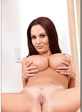 Engaging hooker Ava Addams posing naked and showing big oiled tits