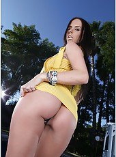 Stunning brunette babe Brandy Aniston with her huge and lovely tits posing