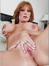 Erotic milf Darla Crane posing in her bedroom and rubbing boobies
