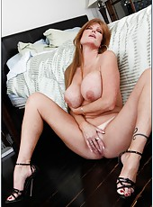 Erotic milf Darla Crane posing in her bedroom and rubbing boobies