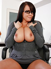 Big titted brunette milf Brandy Talore rubs her huge boobs and plays with a pussy
