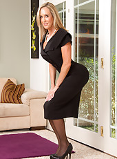 Lovely Brandi Love is doing an eye-catching striptease just to please us