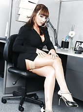 Hot Lily Paige in sexy stockings realizes her orgasmic dreams with office worker