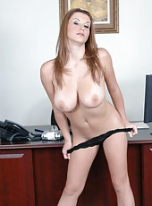 Ultra-busty milf Sara Stone sucks and gets fucked from behind in her office