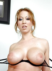 Redhead with sexy eyes named Christina Brooks got her boobs shaked