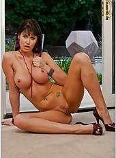 Bewitching slut Eva Karera taking off hot lingerie and fingering on camera