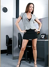 Prodigious milf Michelle Lay showing her amazing forms in the office