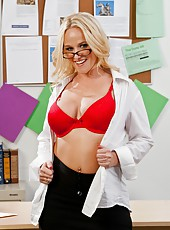 Ultra-busty blonde in sexy glasses Dee Siren strips, sucks and fucks like a wild