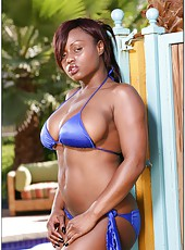 Arresting ebony Jada Fire showing her sweet body in blue bikini on the pool