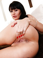 Eva has plays with her huge boobs and masturbates to get pleasure