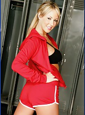 Arresting blonde Carolyn Reese shows off her big tits and seduces a man in the locker room