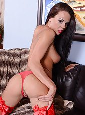 Sexy dark haired lady Rahyndee James looks amazing in the alluring red lingerie
