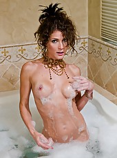 Jenni Lee is a sexy and horny milf with curly hair, long legs and a lot of hot ideas