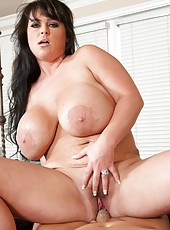 Fatty milf with giant boobs and hot eyes Indianna Jaymes poses before fucking