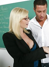 Blonde with large boobs Holly Sampson in a hot teacher that loves to fuck