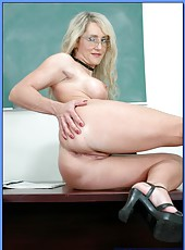Fascinating blonde teacher in glasses Lori Lust seduces hungry student