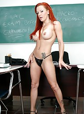 Fascinating redhead teacher Shannon Kelly strips and fucks in the classroom
