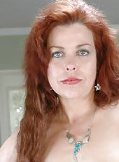 Beautiful and busty milf Susan Evans masturbates with her naughty fingers