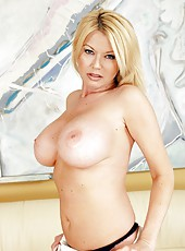 Busty and slutty babe Carolyn Monroe rubs her huge boobs and sweet holes