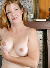 Nasty mature Jules shows her shaved pussy and sweet natural tits