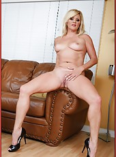Cuddly curve Ginger Lynn loves doing naughty things with her genitals