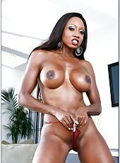 Oiled bitch Diamond Jackson posing naked and teasing big boobies