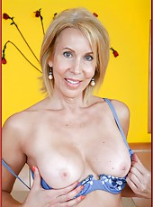 Wild milf Erica Lauren showig delicious tits and masturbating on camera
