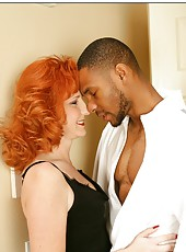 Redheaded milf Sasha Brand getting naughty with her black friend