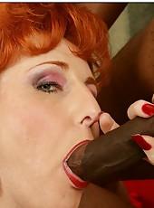 Redheaded milf Sasha Brand getting naughty with her black friend