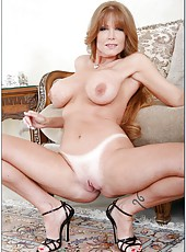 Glamorous bitch Darla Crane undressing on camera and playing with tits